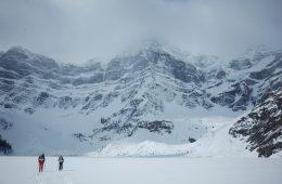 Howse Peak Jess and David skiing across Chephron Lake April 15
